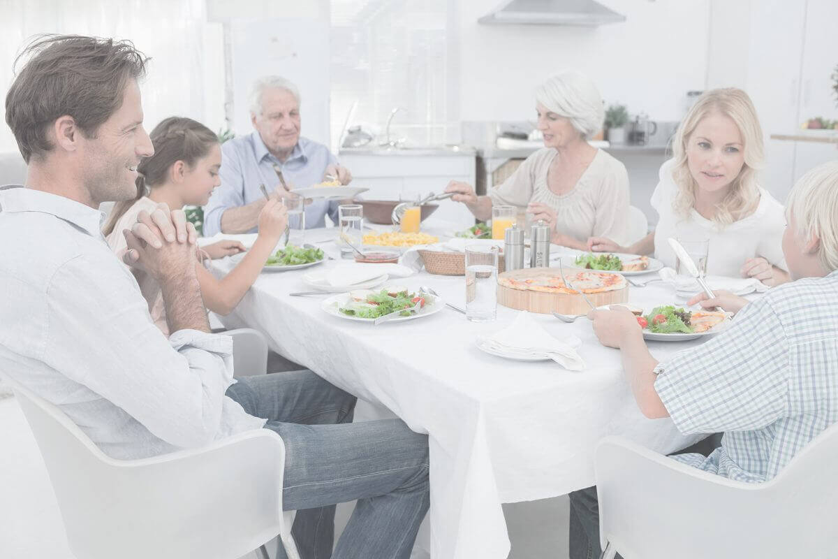 Extended family at the dinner table in kitchen image